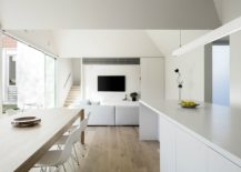 Minimal-interior-in-white-with-wooden-floor-and-sliding-glass-doors-217x155