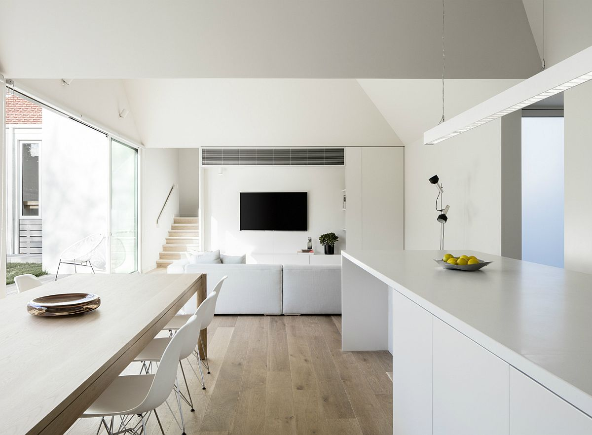Minimal interior in white with wooden floor and sliding glass doors