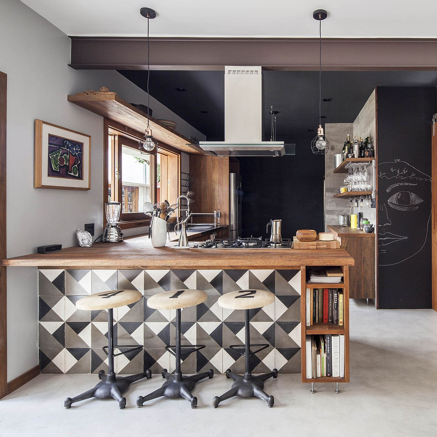Modern-kitchen-with-chalkboard-walls-wooden-counters-and-geometric-tiles