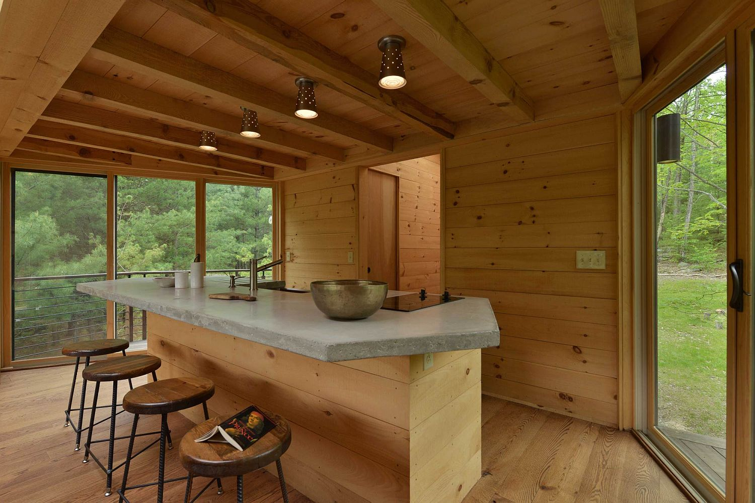 Modest kitchen of the treehouse with breakfast bar