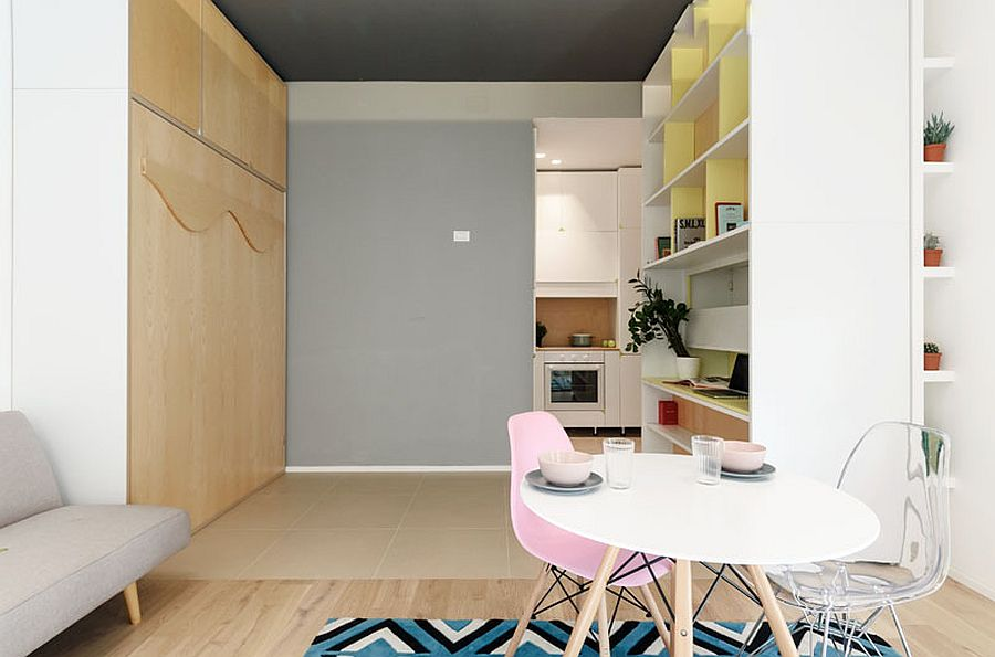 Moving wall with shelves can create multiple living configurations 2