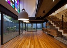 Multi-colored-glass-panes-on-the-top-level-bring-brightness-to-the-interior-217x155