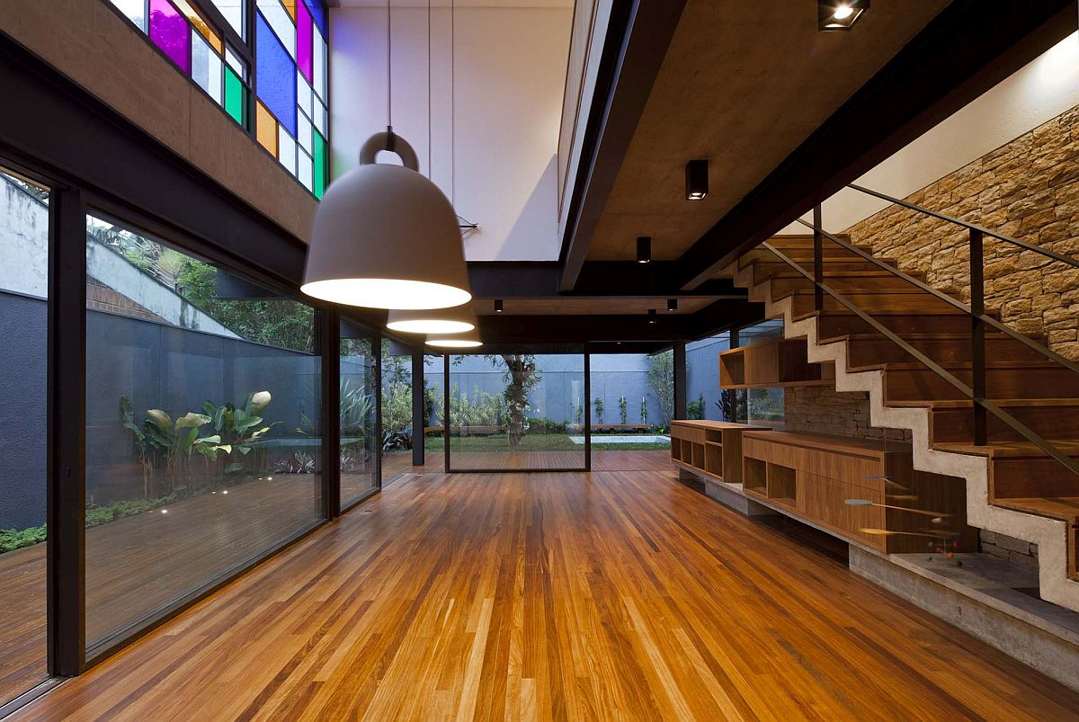Multi-colored glass panes on the top level bring brightness to the interior