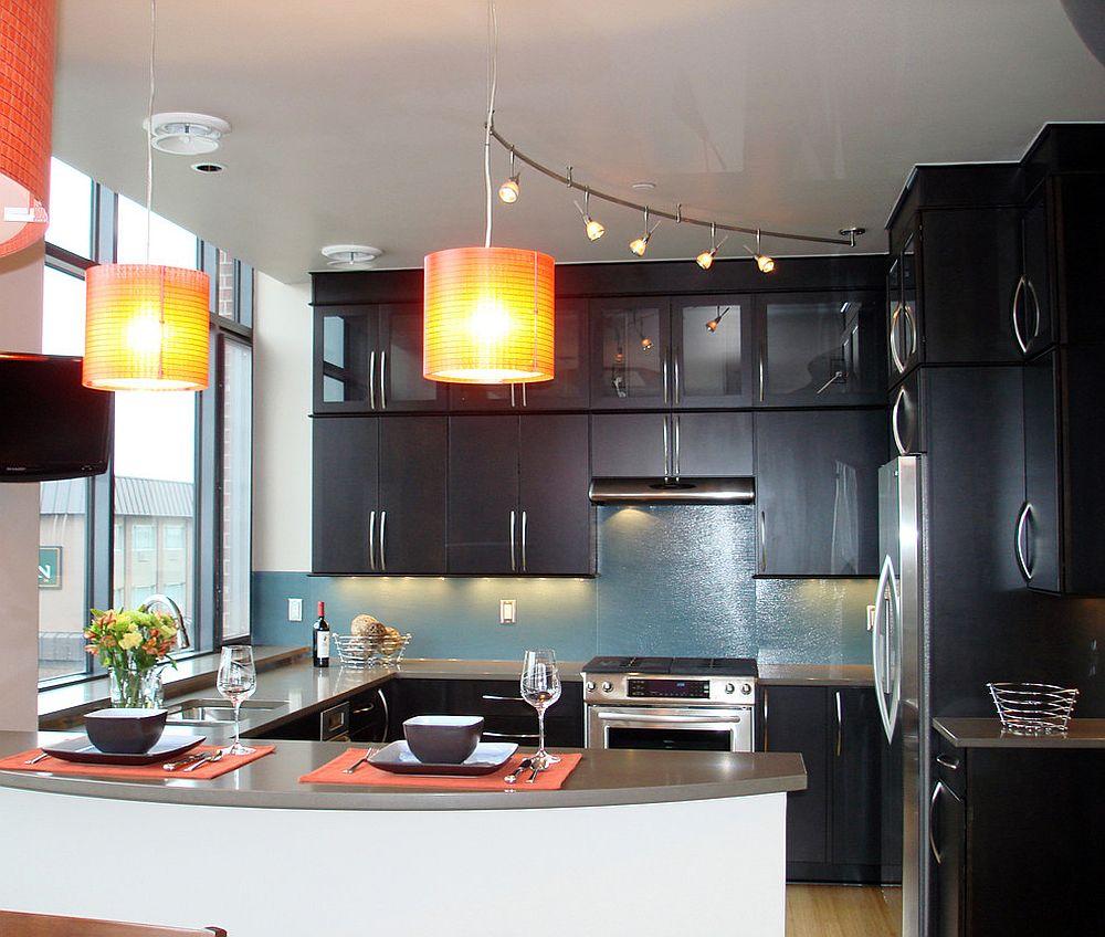 Orange-pendants-enliven-kitchen-with-dark-ambiance