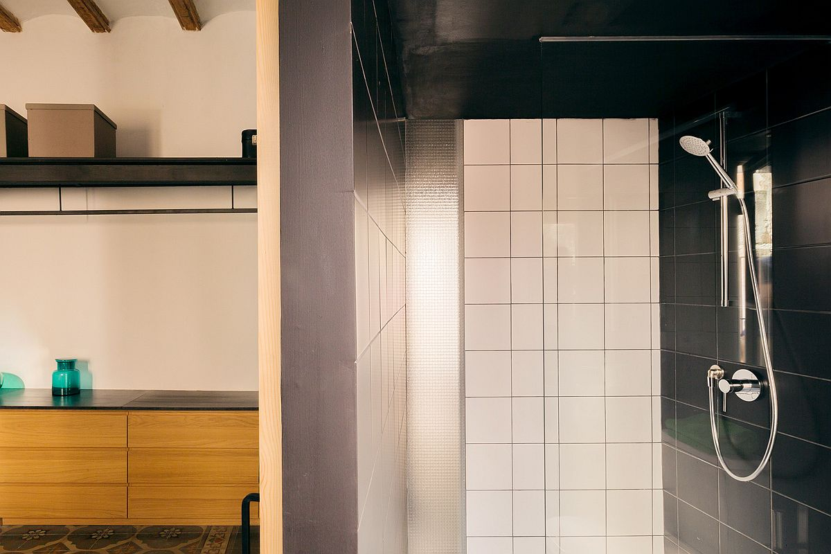 Refined-and-space-savvy-contemporary-bathroom-in-black-with-natural-lighting
