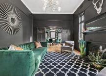 Regal-living-space-in-gray-with-emerald-green-couch-and-plenty-of-sophistication-217x155