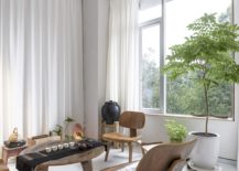 Relaxing-tea-room-with-wooden-decor-and-drapes-in-white-217x155