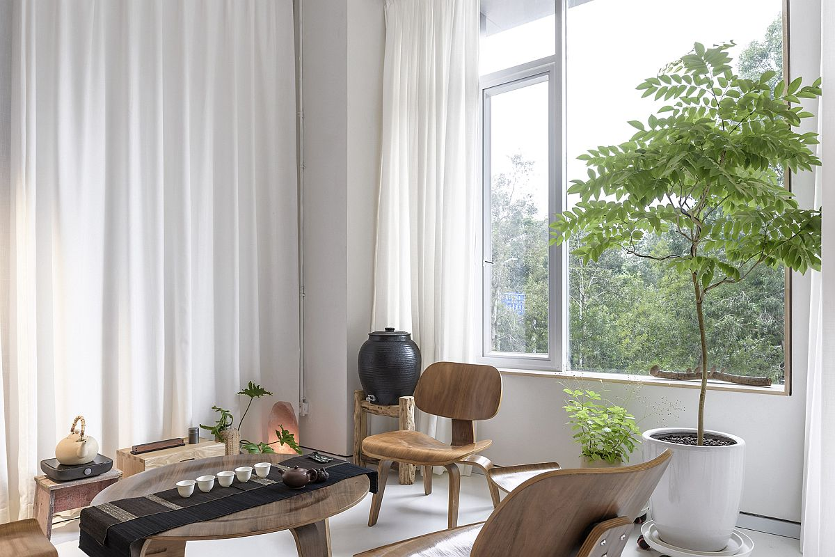 Relaxing tea room with wooden decor and drapes in white