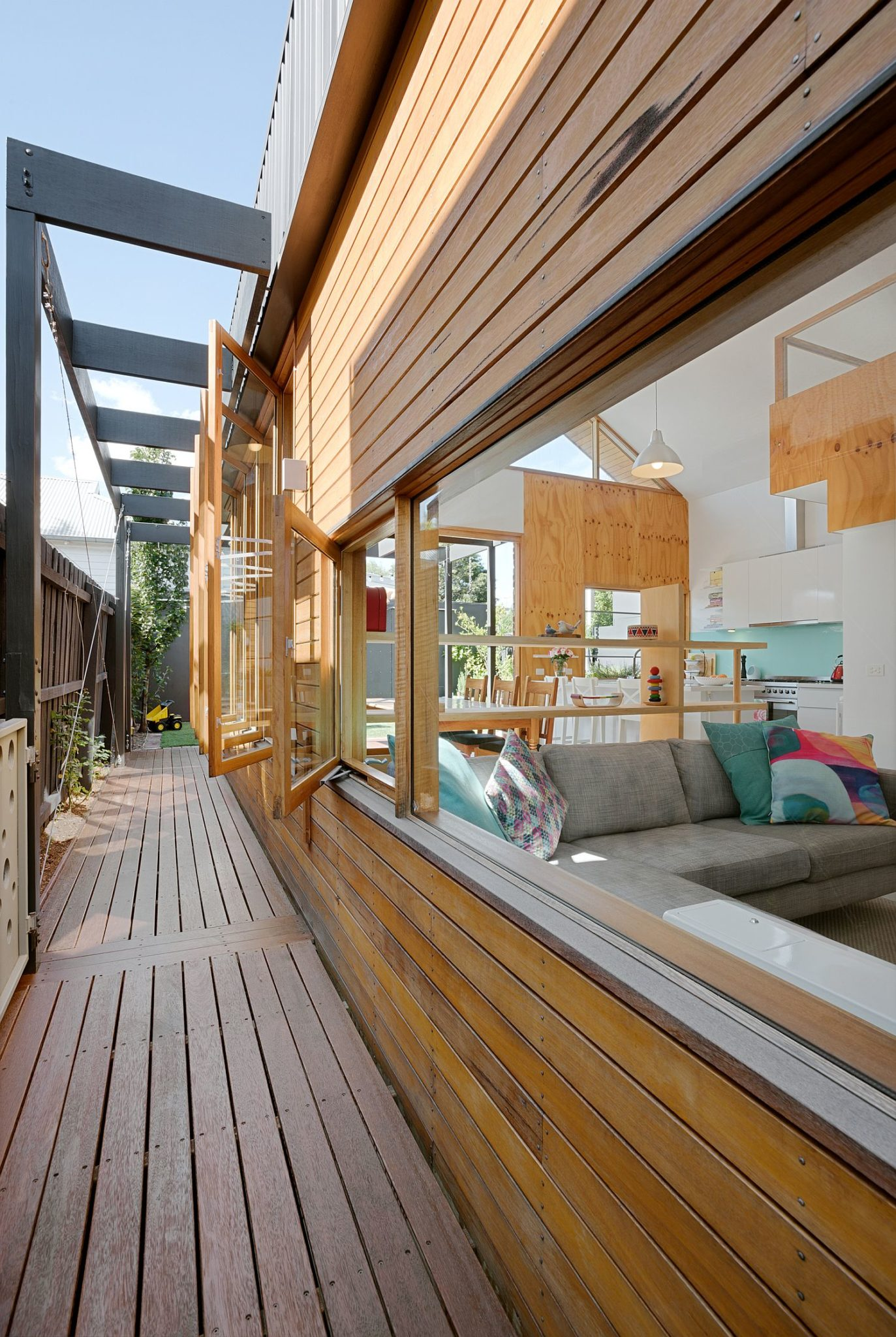 Series of windows and a wooden exterior define the exterior of the Aussie home