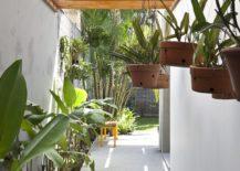 Shaded-walkway-with-greenery-around-it-217x155