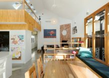 Simple-wooden-shelves-used-as-room-divider-between-the-living-area-and-dining-217x155