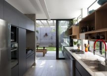Sliding-glass-doors-connect-the-light-filled-kitchen-with-the-garden-outside-217x155