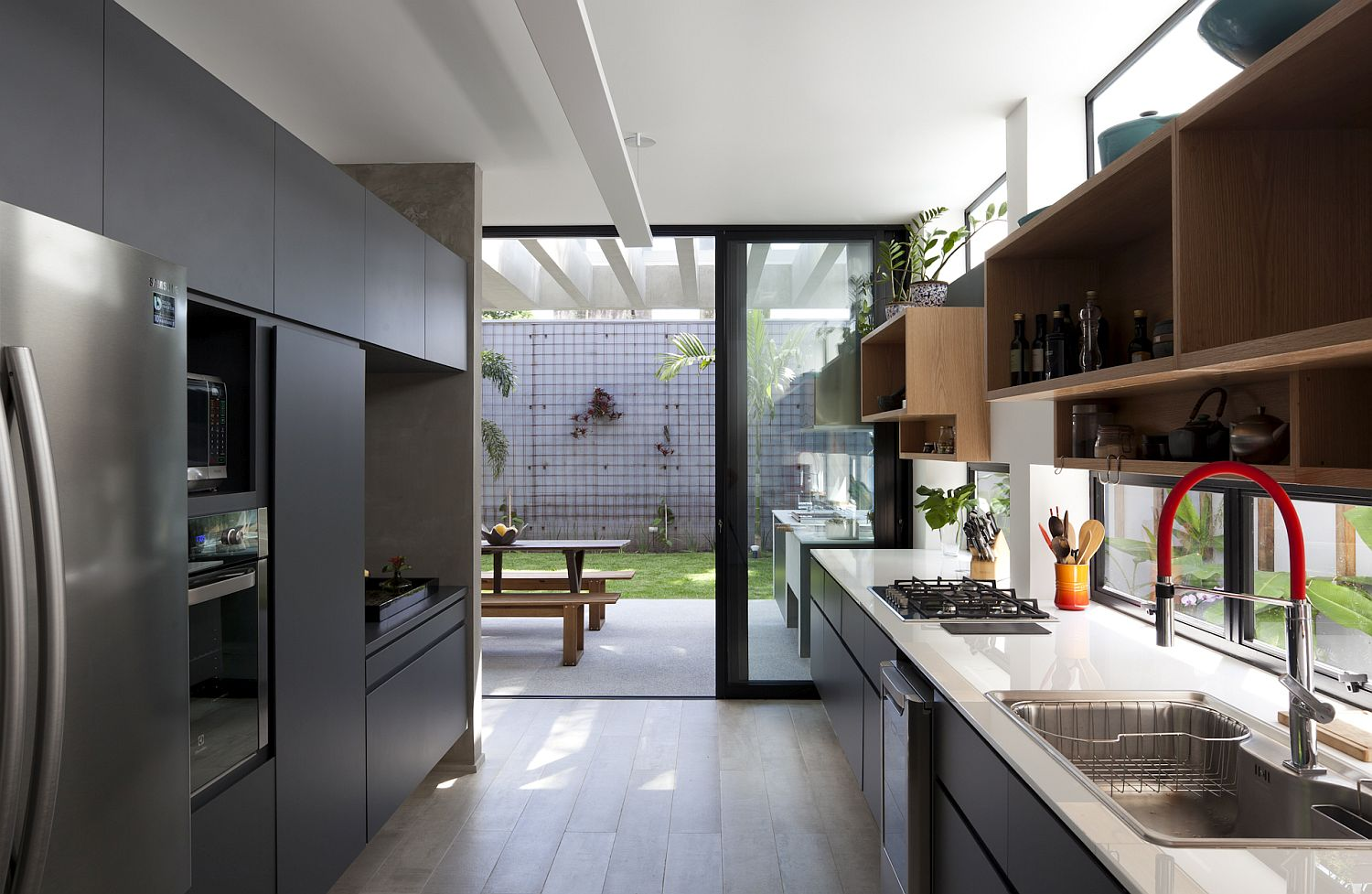 Sliding glass doors connect the light-filled kitchen with the garden outside