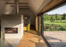 Sliding-glass-doors-connect-the-living-area-and-fireplace-with-the-sunny-deck-outside-217x155