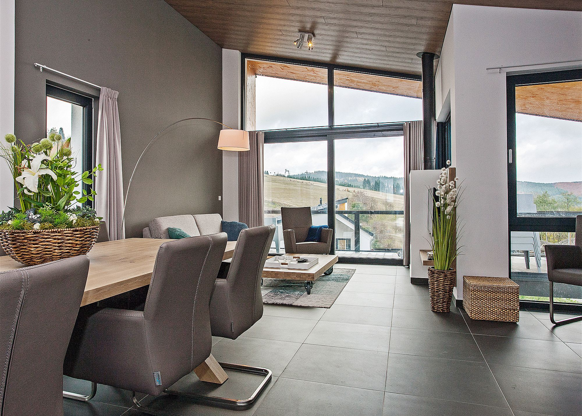 Sloped roof of the villa gives the interior a cool, modern look