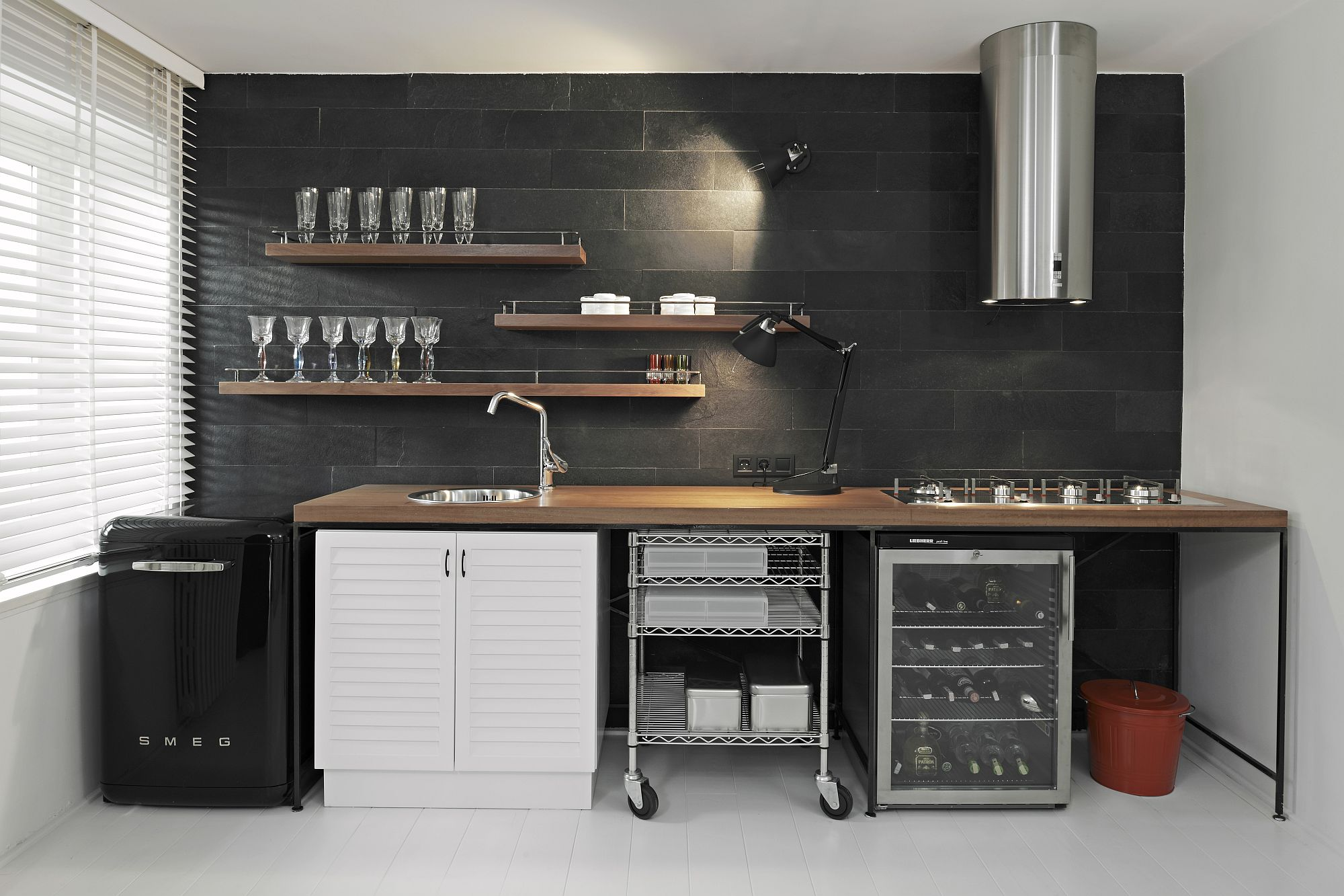 Small-kitchenette-with-a-small-Smeg-refrigerator