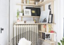Smart-wooden-corner-shelf-for-the-space-savvy-reading-nook-217x155