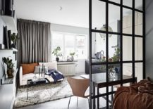 Space-savvy-Scandinavian-style-living-room-with-a-small-couch-in-white-217x155