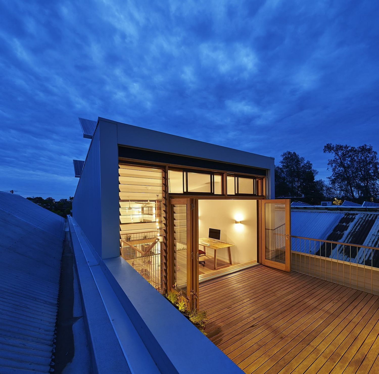 Studio-on-the-top-floor-leading-to-the-wooden-deck-outside