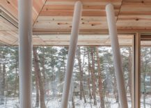 Supporting-beams-inside-the-One-Year-House-draw-inspiration-from-the-trees-outside-217x155