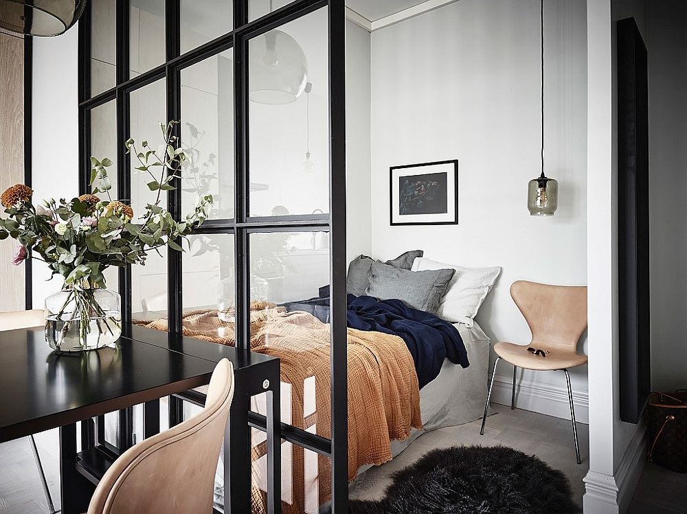 Tiny bedroom for the small apartment with sliding glass door