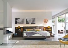 Unique-bed-frame-and-bedside-tables-integrated-into-the-headboard-217x155