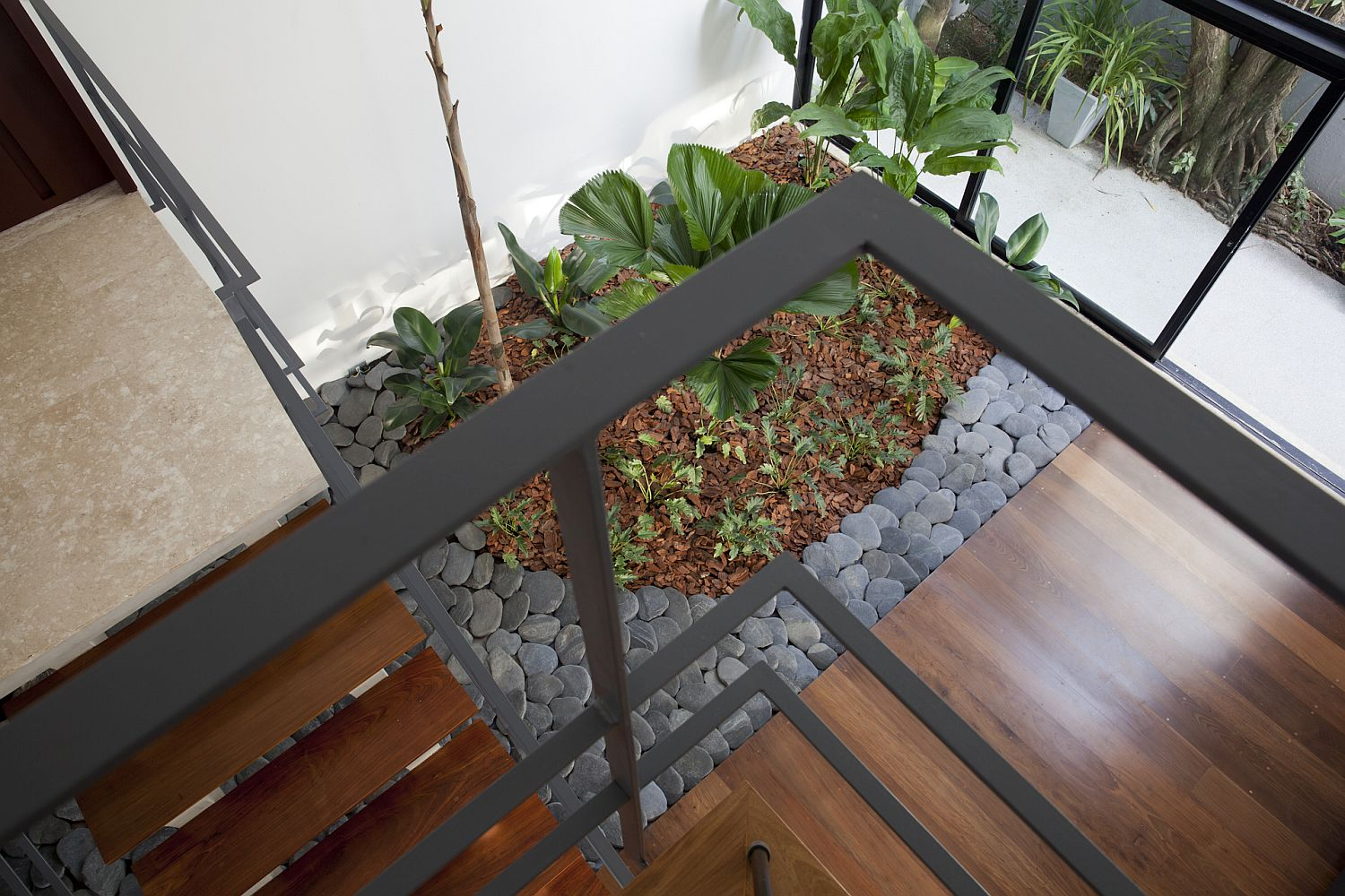 View of the internal garden from the upper level of the contemporary home