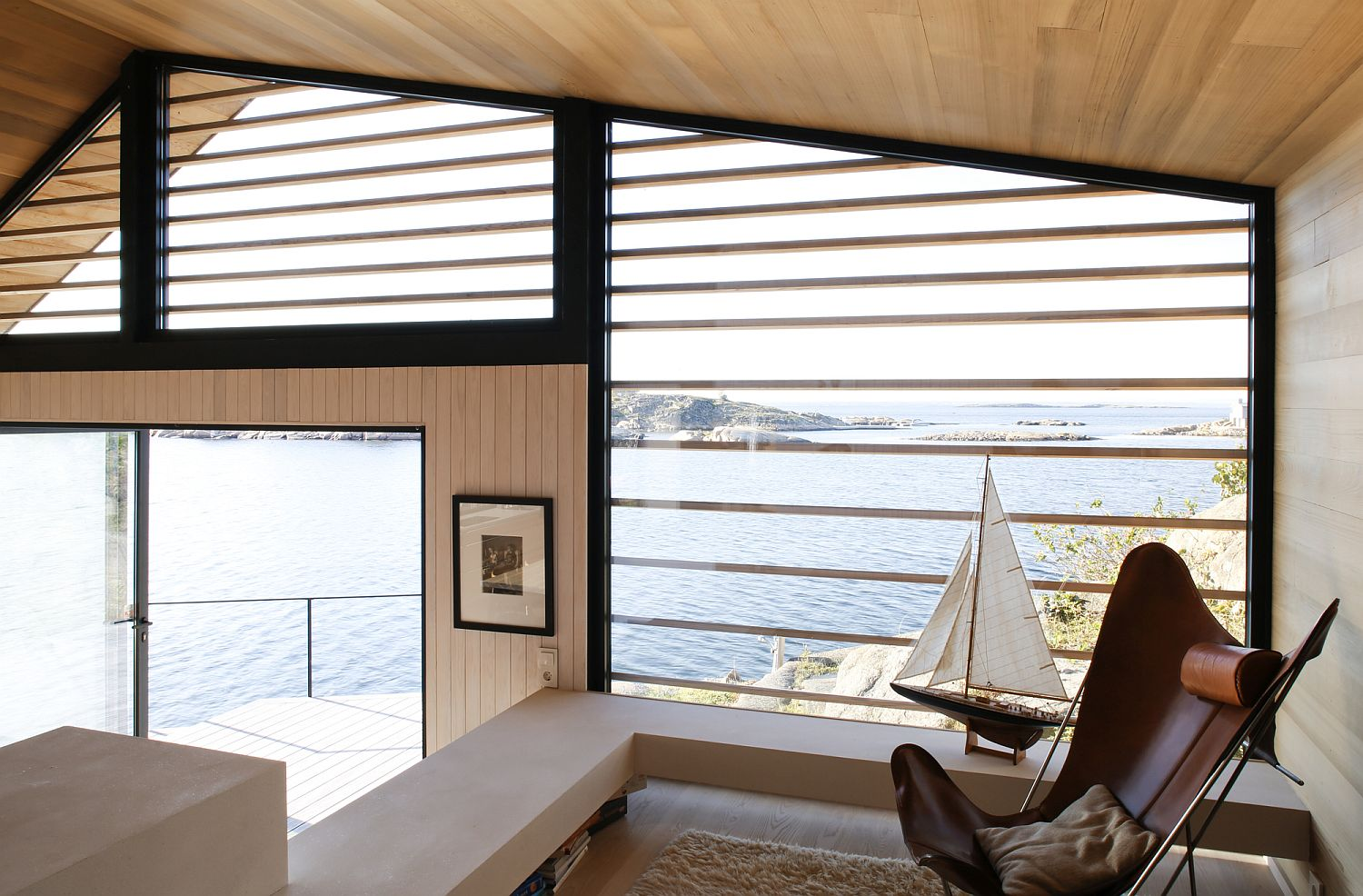 View-of-the-sea-and-the-coastal-landscape-from-the-comfy-nook-inside-the-cabin