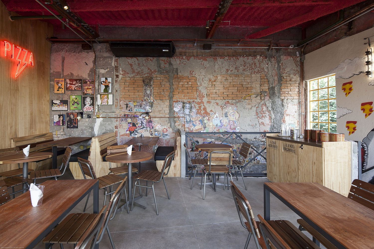 Walls-of-the-interior-with-exposed-brick-wall-sections-and-distressed-finish