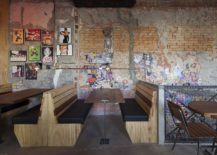 Weathered-walls-of-the-pizza-restaurant-with-framed-photographs-and-posters-217x155