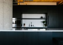White-backsplash-stands-out-in-the-kitchen-thanks-to-black-cabinets-and-dark-gray-island-217x155