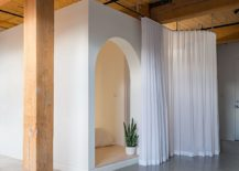 White-drapes-slide-across-to-give-those-inside-the-bedroom-ample-privacy-217x155