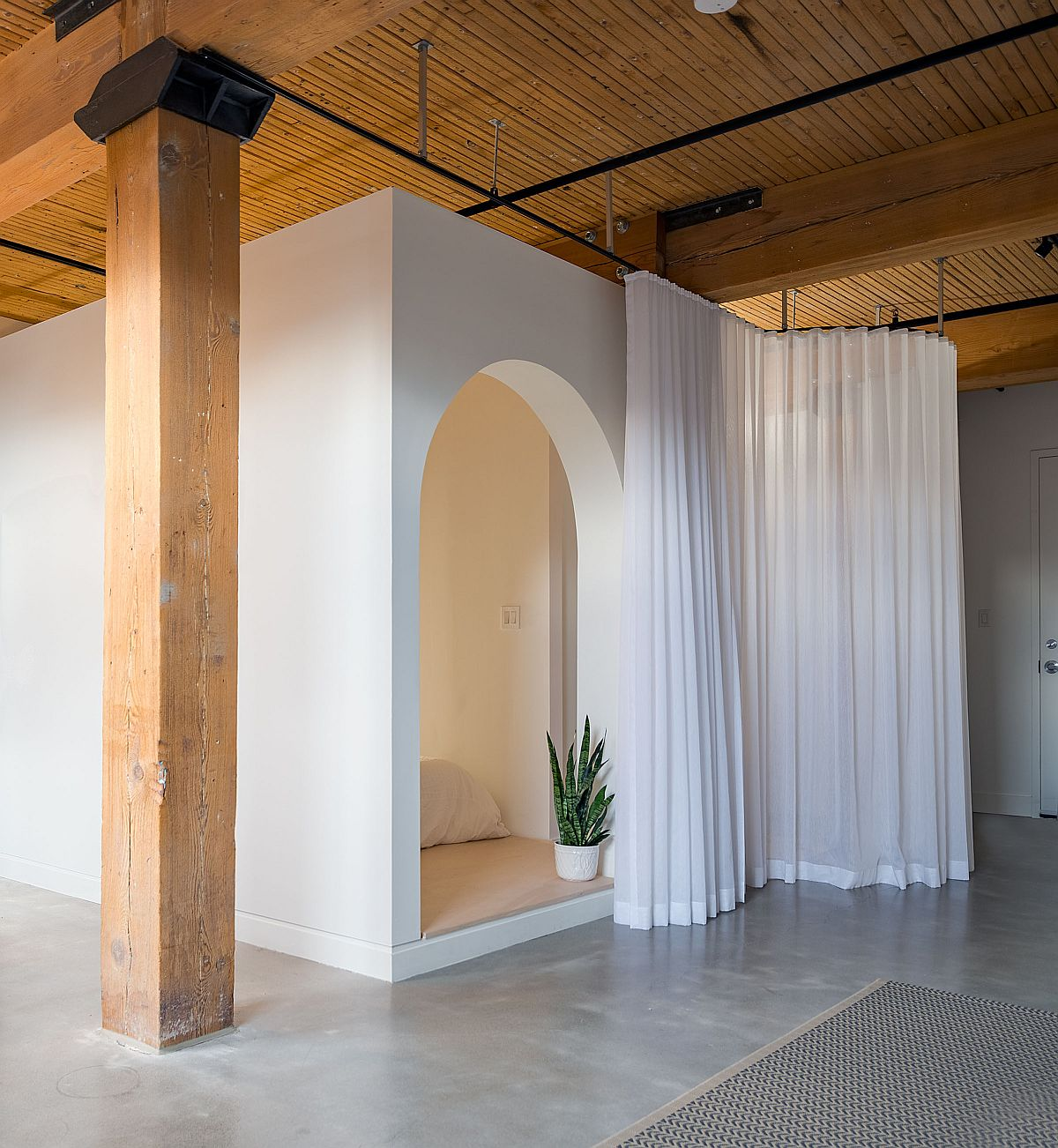 White drapes slide across to give those inside the bedroom ample privacy