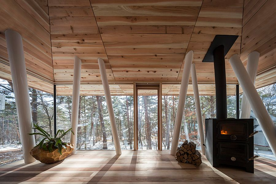 Wooden interior of the Japanese vacation home with glass window walls