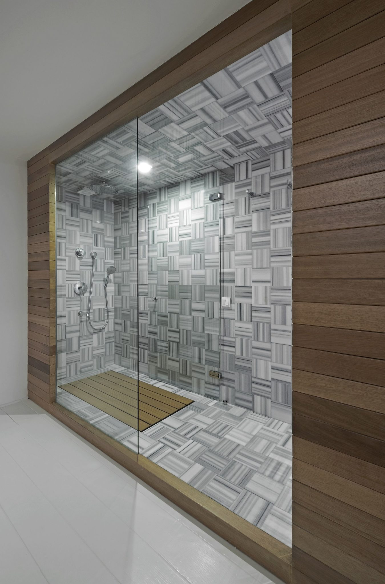 Wooden shower cabin brings warmth to the interior