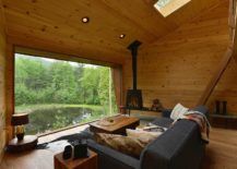Woodsy-interior-of-the-Inhabit-cabin-with-stunning-views-of-the-landscape-217x155