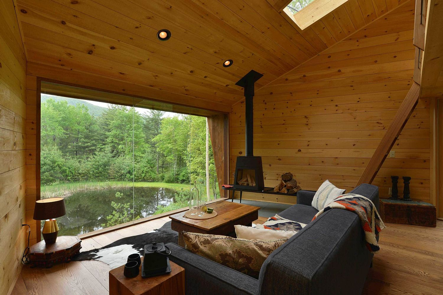 Woodsy interior of the Inhabit cabin with stunning views of the landscape