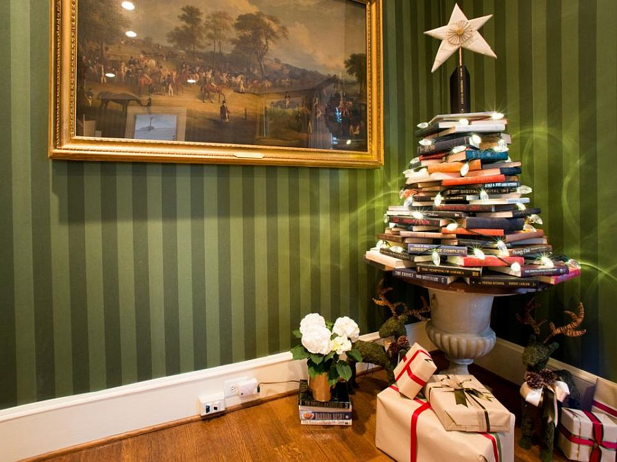 A pile of books and string lights can make a beautiful Christmas tree!
