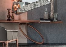Beautiful-and-slim-console-table-with-a-wheel-styled-circular-base-217x155
