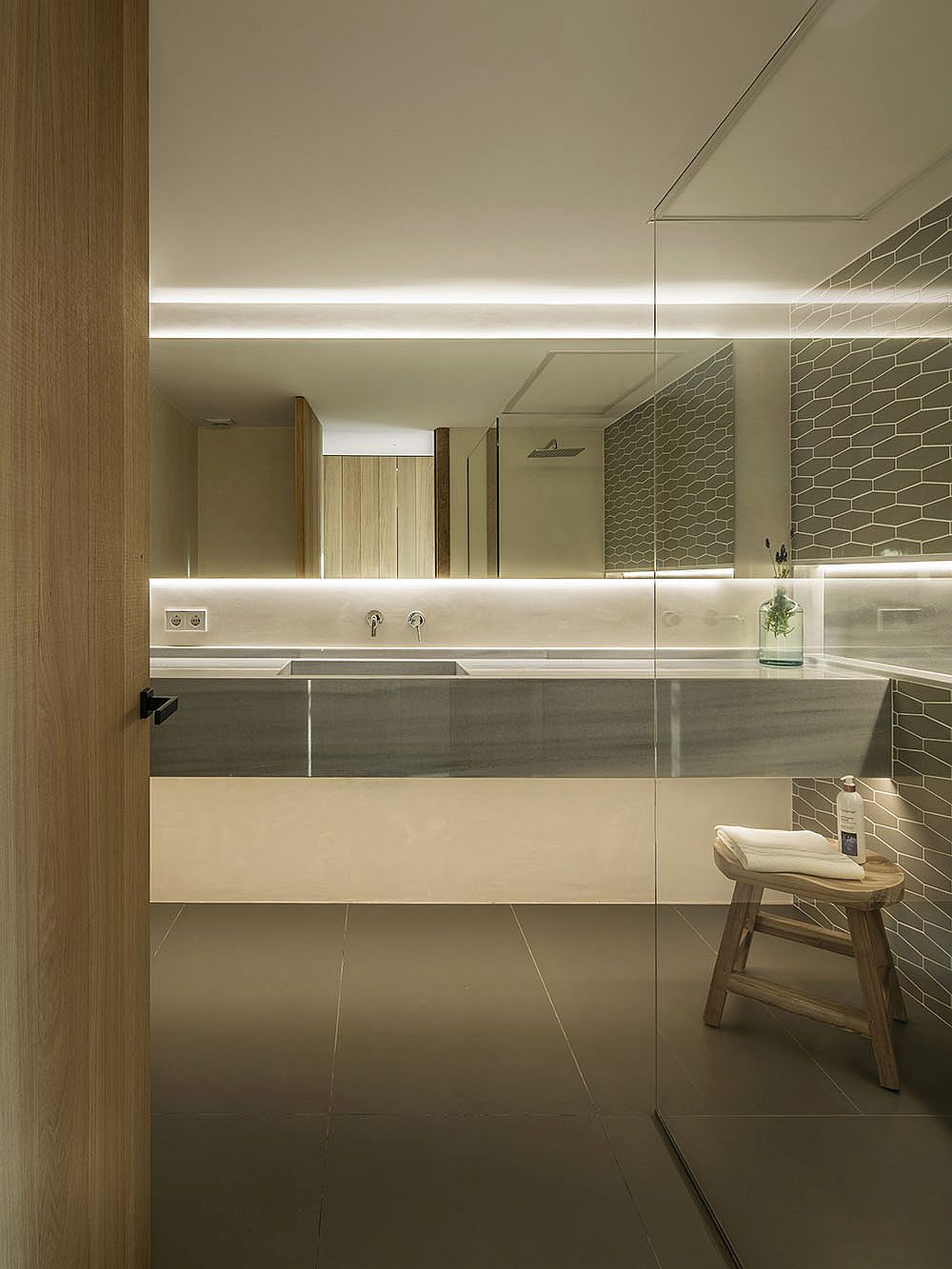 Beautifully backlit glass for the contemporary bathroom in gray and white