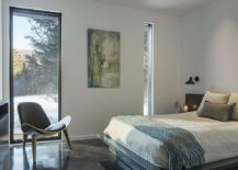 Bedroom-with-a-view-of-the-snow-covered-meadows-and-the-woods-beyond-217x155