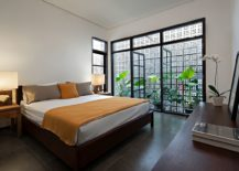 Bedroom-with-framed-glass-doors-is-filled-with-ample-natural-light-217x155