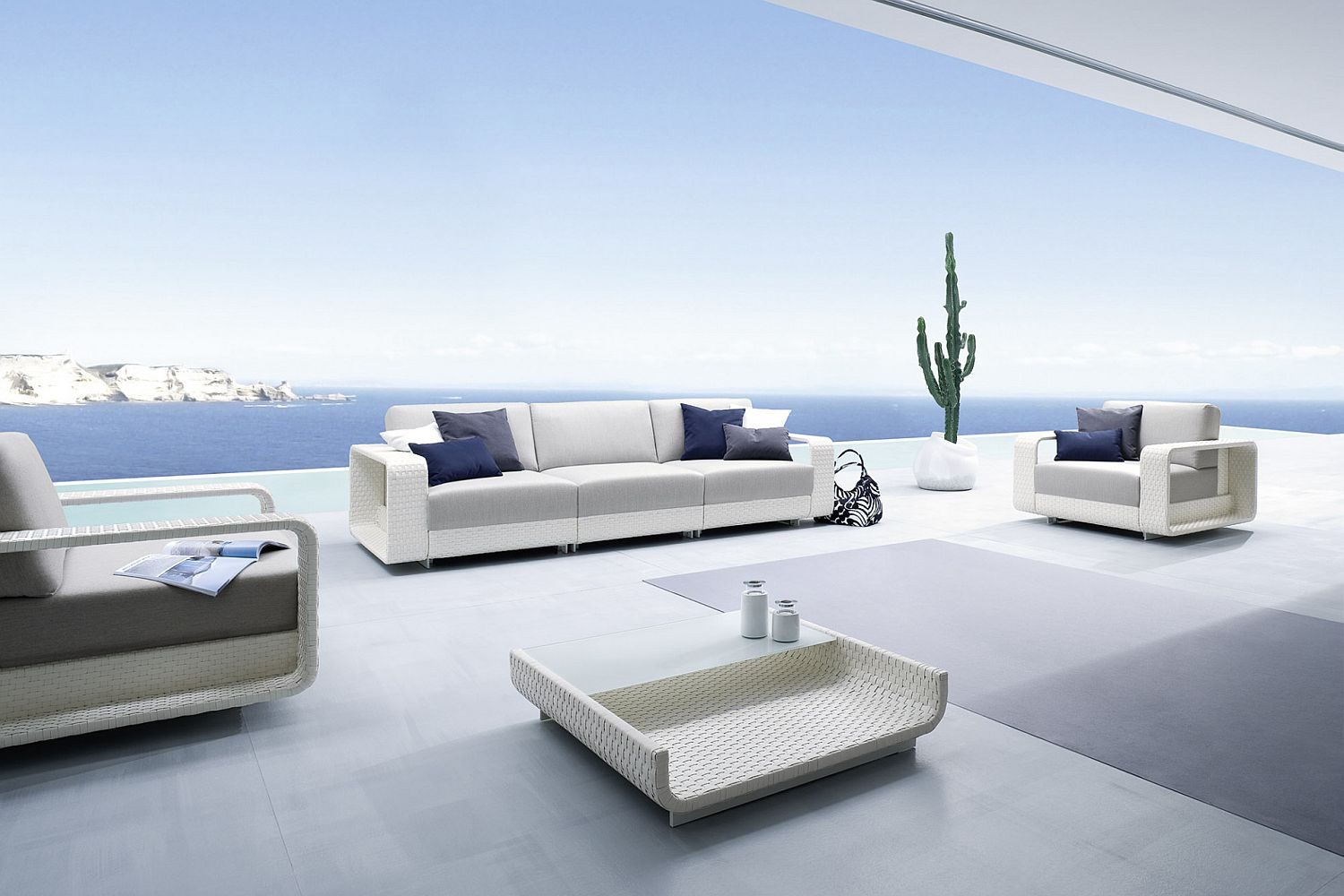 Blue, white and gray outdoor furniture for the coastal style deck