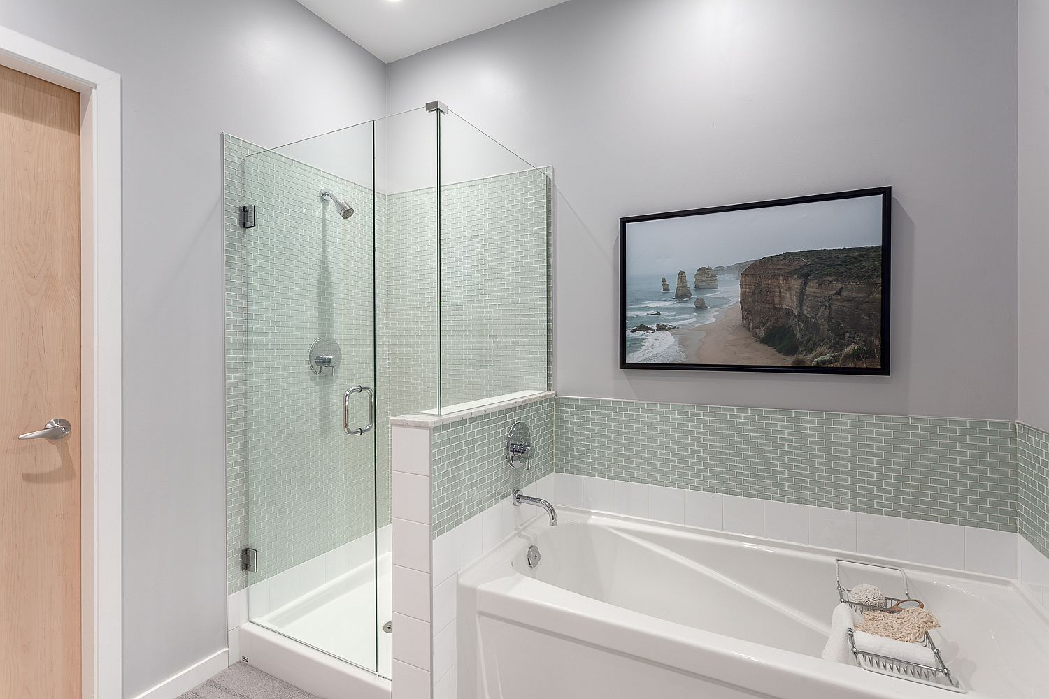 Contemporary bathroom with bathtub and glass shower in the corner