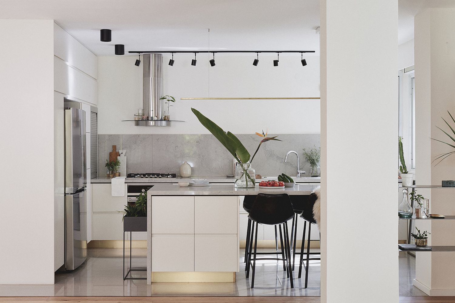 Contemporary kitchen with lovely track lighting and refined, modern design