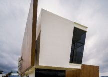 Curved-facade-of-the-home-along-with-a-wind-breaker-that-also-brings-pivacy-217x155