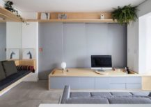 Custom-wooden-seating-and-sliding-walls-for-the-small-living-room-of-Sao-Paulo-home-217x155