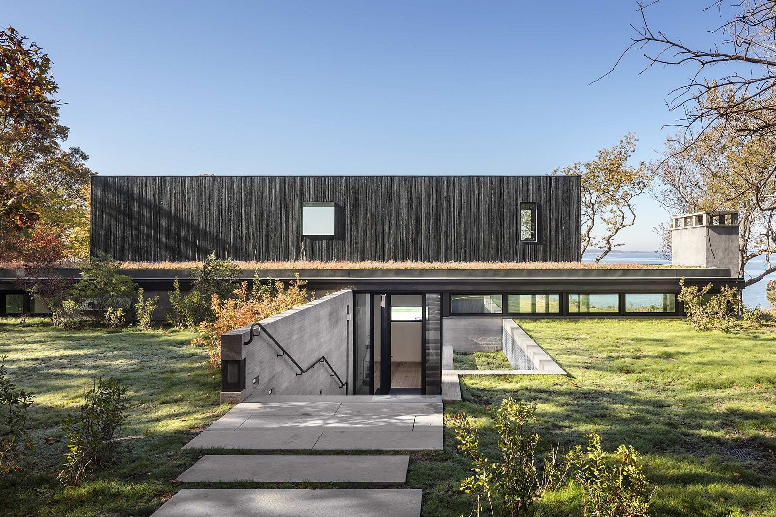 Cut in the earth creates a private entry to the house with Bay views