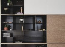 Dark-metallic-cabinet-stands-out-visually-when-placed-next-to-the-white-backdrop-217x155