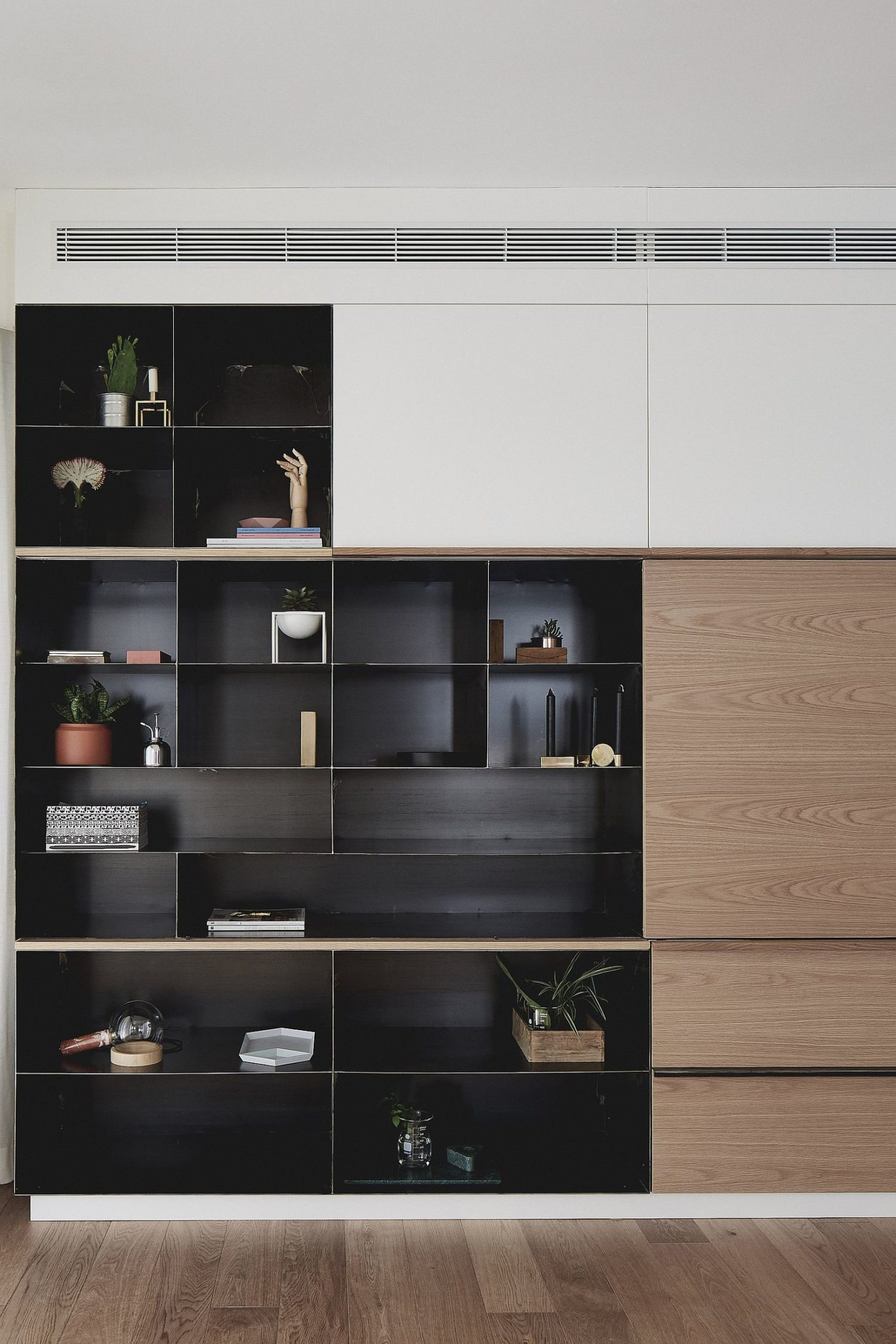 Dark-metallic-cabinet-stands-out-visually-when-placed-next-to-the-white-backdrop